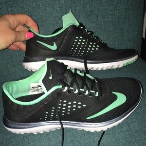 Black and aqua Nike shoes. Size 7.5